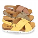 NUBUCK leather sandal shoes for toddler girls with crossed straps and white soles.