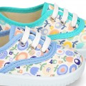 Cotton canvas Bamba shoes with flower design for kids.