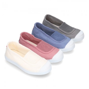 Cotton canvas kids Bamba type shoes with central elastic band and toe cap.