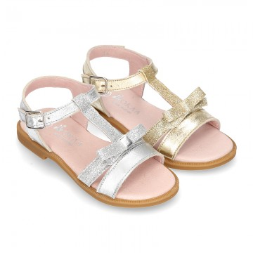 Metal Nappa Leather Sandal shoes with bow and shiny effects for toddler girls.