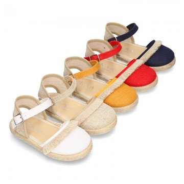 New LINEN canvas espadrilles with buckle fastening and fringed design for girls.
