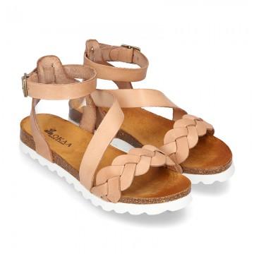 Nueva Sandalia Niña Mayor en piel atada al tobillo y diseño trenzado.