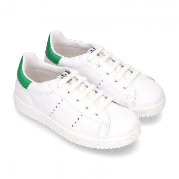 New trendy casual tennis shoes with green counter.