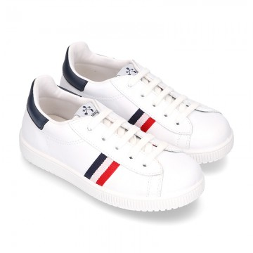 Casual washable leather kids tennis shoes with flag design.