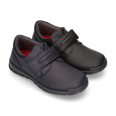 New School shoes Blucher style with velcro strap in washable leather.