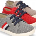New WASHED EFFECT canvas tennis style shoes with flag detail.