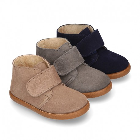Suede leather casual ankle boots with velcro strap.