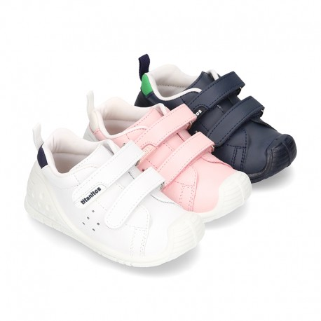 New Washable leather Tennis shoes with dual velcro strap and reinforced toe cap and counter for first steps.