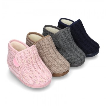 Wool knit ankle home shoes with covert velcro strap.