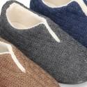 Zapatilla de casa cerrada con abertura en lana estructurada.