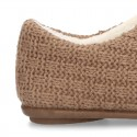 New structured wool knit home shoes with central opening.
