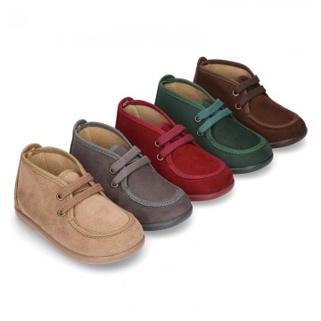 Autumn Canvas ankle booties wallabees style with ties closure.