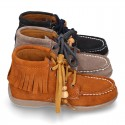 INDIAN style ankle boots with fringed design in suede leather.