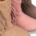 Suede leather boot shoes with fringed detail for toddler girls.