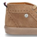 Suede leather ankle boots tennis style with chopped design.