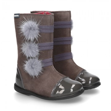New combined boots in suede leather with patent finish and POMPONS design.
