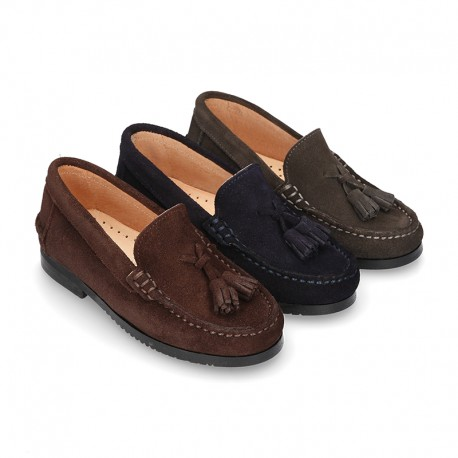 Classic suede leather moccasins with tassels and thick soles.