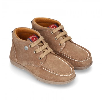 New Moccasin style ankle boots in suede leather.