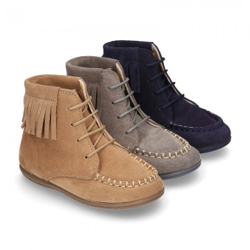MOHICAN style ankle boots with fringed design in suede leather.