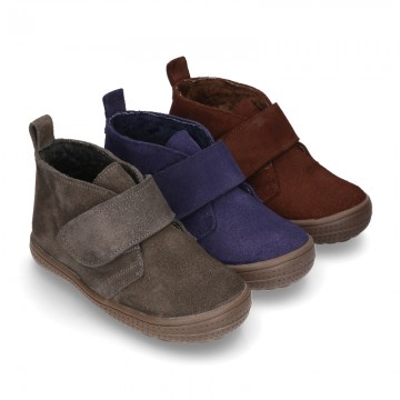 New Casual Suede leather ankle boots with velcro strap and fake hair lining.