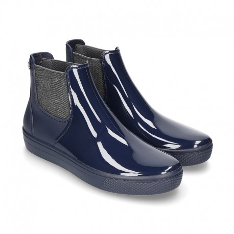 SHINY Ankle rain boots with elastic band and SNEAKER DESIGN.