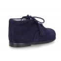 Suede leather Welsh or English style ankle boots with tassels.