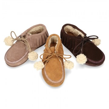 Little Ankle boot shoes Wallabee style with POMPONS and fringed design and with fake hair lining in suede leather.