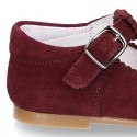 Classic Suede leather T-strap shoes with scallop and buckle fastening.