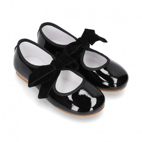 0fd06999d103e7 Okaaspain, tienda online de merceditas tipo angelito co lazo en piel charol  negro para niñas.