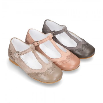 New T-strap little Mary Janes combined in soft suede leather with soft nappa leather.