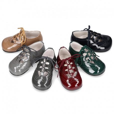 Patent leather little kids English style shoes in autumn colors.