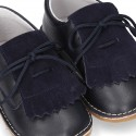 Little Classic Oxford style shoes with fringed design and flexible soles in combined leather.