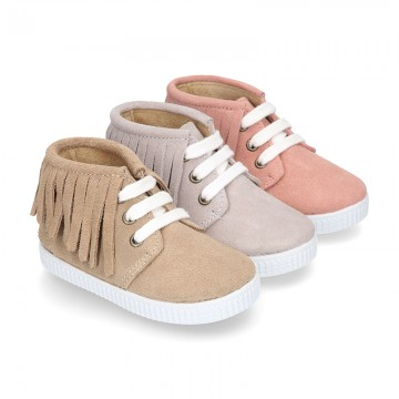 New suede leather Ankle boots with fringed design.