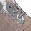 Baby safari boots combined in suede and patent leather.