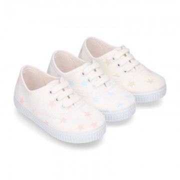 Cotton canvas Bamba type shoes with shoelaces and stars print.