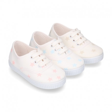 Cotton canvas Kids Bamba type shoes with shoelaces and stars print.