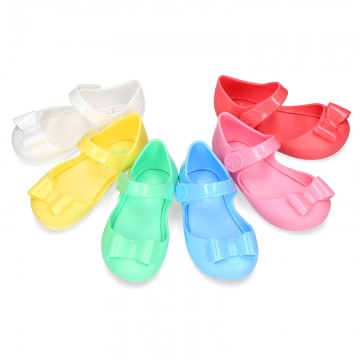 Jelly shoes Ballet flat style with ribbon and hook and loop strap.