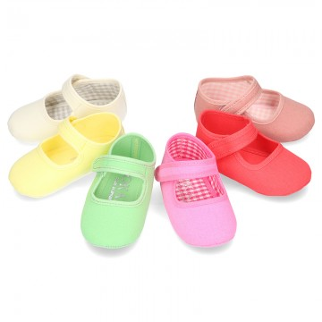 Cotton canvas baby little Mary Janes with velcro strap in seasonal colors.