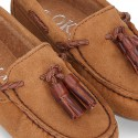Moccasin shoes with tassels in suede leather color for kids.