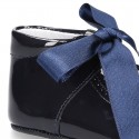 Patent leather little Mary Jane shoes for babies with ties closure.