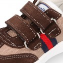 Combined canvas suede leather kids tennis shoes with hook and loop strap .