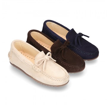 Suede leather Moccasin shoes with bows for toddler kids.