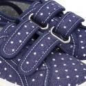 Zapatilla con doble velcro en lona jeans con ESTRELLAS.