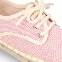 Laces up espadrille shoes in washing effect cotton canvas in pastel colors.