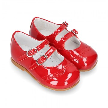Classic little Mary Jane shoes in RED patent leather with double buckle fastening and perforated design.