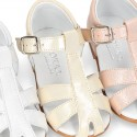 METAL leather Little caged Sandal shoes with buckle fastening.