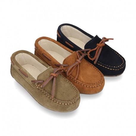 Classic Suede leather Moccasin shoes with Bows in leather color design.