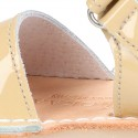 Patent leather Menorquina sandals with velcro strap.