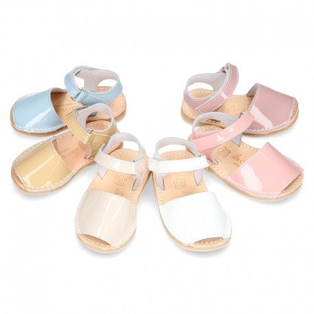 Patent leather Menorquina sandals with hook and loop strap.