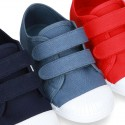 Cotton Canvas Sneaker with toe cap and double velcro strap.